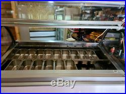 Ice cream display freezer ISA millennium 18 pan white front and steel counter