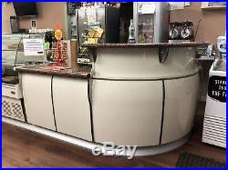 Stunning coffee shop counter with refrigerated displays